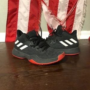 Red and black Adidas Bounce basketball shoes